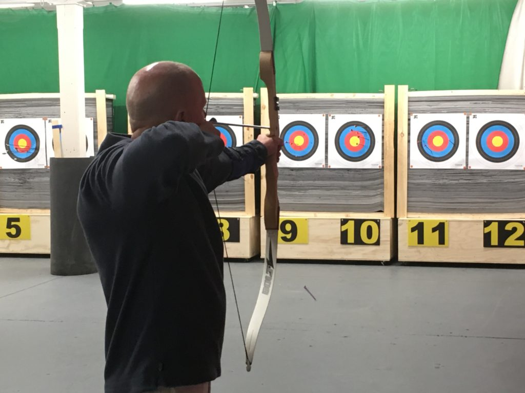 An archer at Sattva's indoor range.